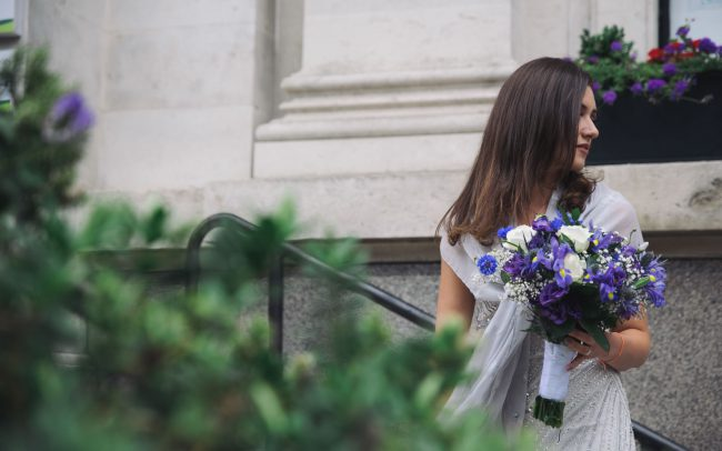 bride outside the islington town hall in london