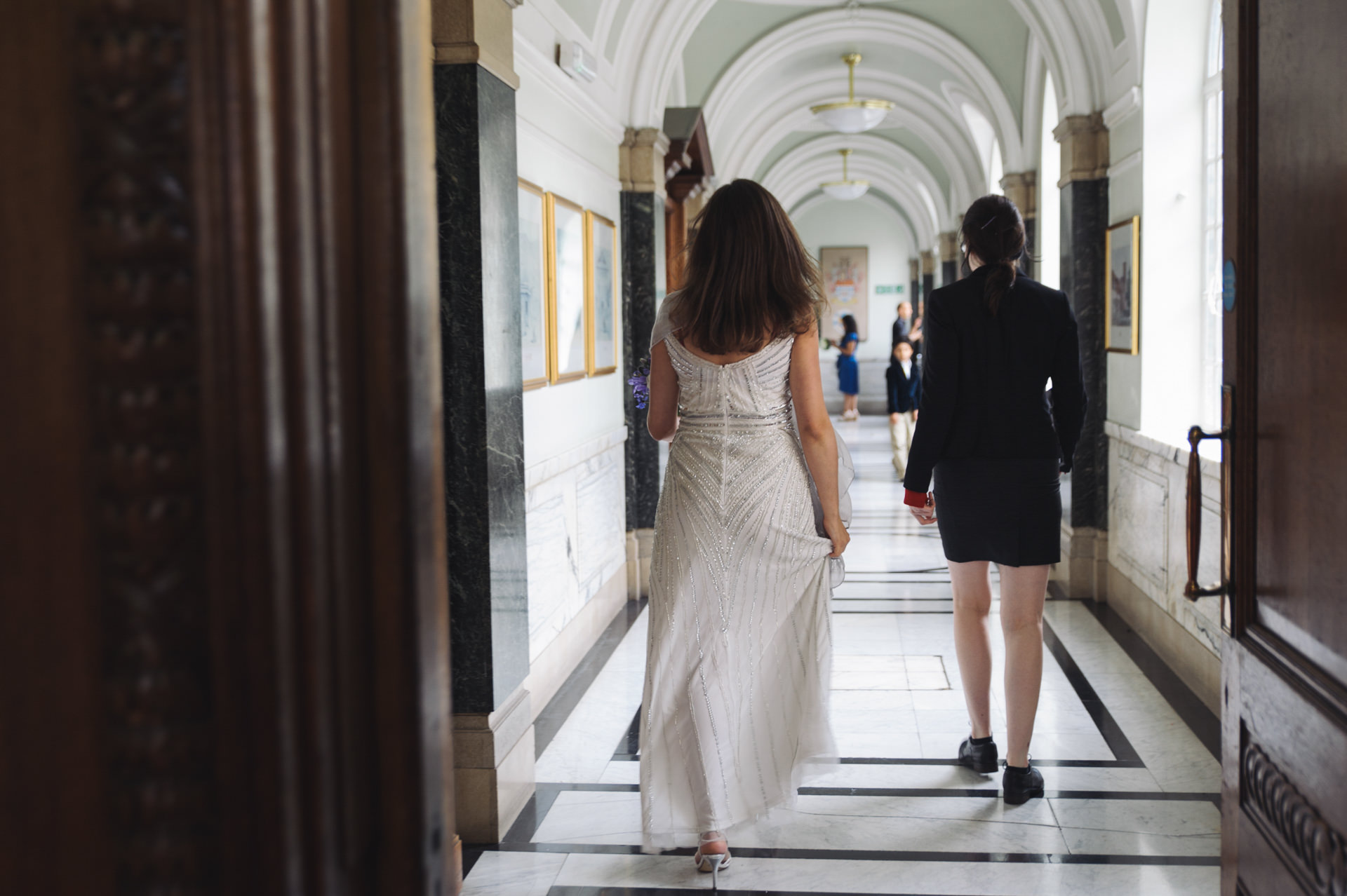 islington town hall wedding bride walks dawn the corridor