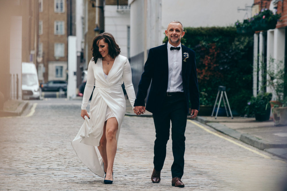 just married couple walks down the road